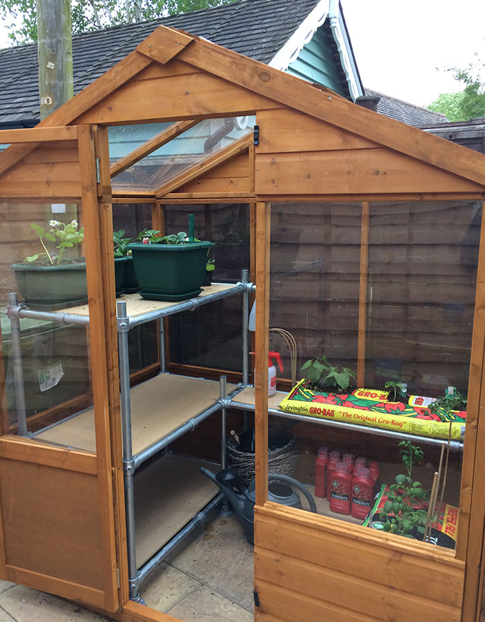 DIY greenhouse shelves