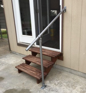 Outdoor handrail for the house entrance