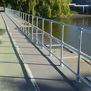 ground based steel handrail system
